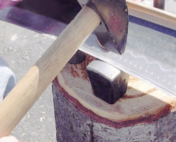 Peening the blade on the anvil